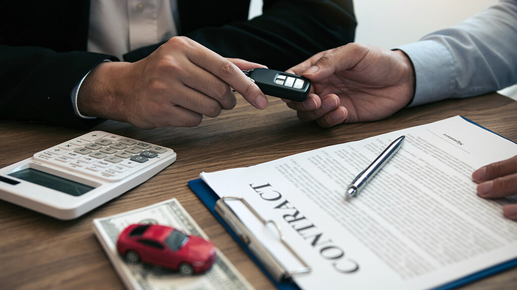 how to sign a car title